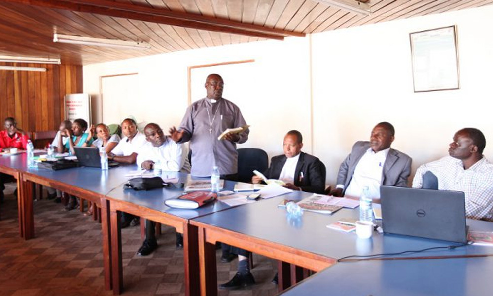 Fr. Gaetano Chairman Rukiga SACCO addressing participants